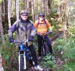 Two mountain bikers on Woodpecker trail