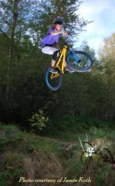 Jumper on Sprockids dirt jumps