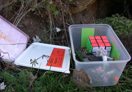Example of a typical geocache in plastic container.